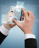 Businessman touching screen of smartphone. Business, internet and technology concept - businessman touching screen of smartphone with news on it Stock Images