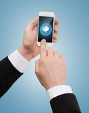 Businessman touching screen of smartphone Stock Photo