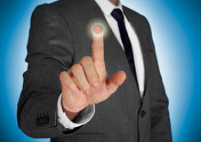 Businessman touching a screen Royalty Free Stock Photo