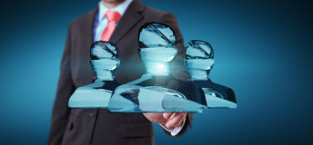 Businessman touching shiny glass avatar group 3D rendering. Businessman on blurred background touching shiny glass avatar group 3D rendering Stock Photo