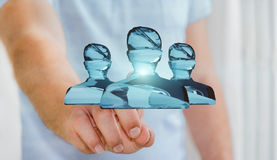 Businessman touching shiny glass avatar group 3D rendering. Businessman on blurred background touching shiny glass avatar group 3D rendering Royalty Free Stock Photos