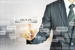 Businessman touching SIGN IN button Royalty Free Stock Images