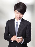 Business man touching smart phone Stock Photography