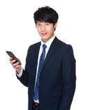 Businessman touching smart phone Royalty Free Stock Images