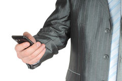 Businessman touching smart phone Stock Photography