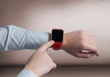 Businessman touching smart watch Stock Images