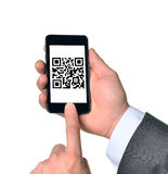 Businessman touching smartphone Stock Images