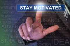 Businessman touching STAY MOTIVATED button on virtual screen Stock Photos