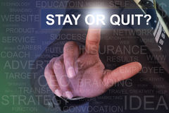 Businessman touching stay or quit button on virtual screen Stock Photography