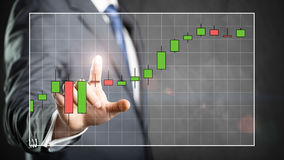 Businessman touching a stock chart Stock Images