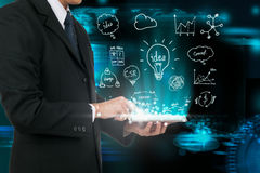 Businessman touching tablet analysis strategy plan the future. Royalty Free Stock Photography