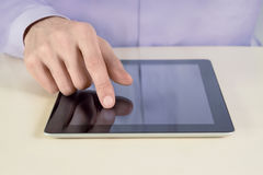 Businessman Touching On Tablet PC. Closeup shot of businessman hands are touching on digital tablet pc. Shallow depth of field on finger Stock Photography