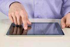 Businessman Touching On Tablet PC. Closeup shot of businessman hands are touching on digital tablet pc. Shallow depth of field on finger Stock Images