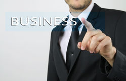 Businessman touching a tactical screen Royalty Free Stock Photos