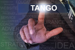 Businessman touching tango button on virtual screen Stock Photography