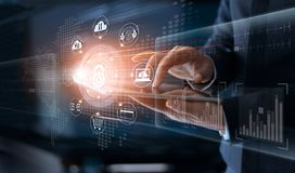 Businessman touching technology global networking security information safety and encryption with icon on virtual screen , Data p. Rotection and Cyber security royalty free stock photography