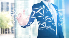 Businessman touching technology interface with professional emai. View of a Businessman touching technology interface with professional email  icon Stock Image