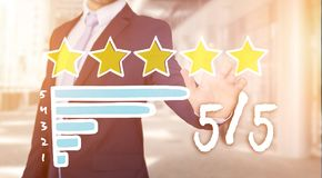 Businessman touching technology interface with ranking stars Royalty Free Stock Photos