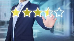 Businessman touching technology interface with ranking stars Stock Photos