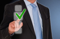 Businessman touching tick sign Stock Photos