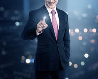 Businessman touching a touch screen Royalty Free Stock Images