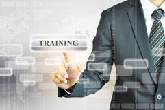 Businessman touching TRAINING sign Stock Image