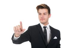 Businessman touching transparent screen Stock Image