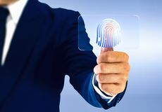 Businessman touching virtual buttons fingerprint.  royalty free stock images