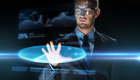 Businessman touching virtual chart projection Stock Image