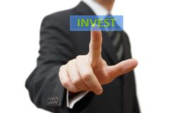 Businessman  touching virtual display with Invest word Royalty Free Stock Images