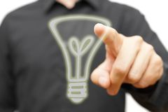 Businessman touching  virtual  light bulb. Concept of idea  or c Royalty Free Stock Photo