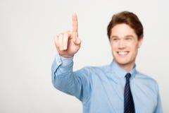 Businessman touching on virtual screen Stock Image