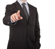 Businessman touching virtual screen or button Royalty Free Stock Photography