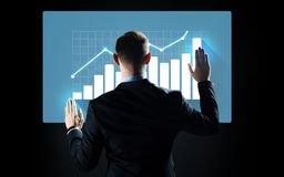 Businessman touching virtual screen with chart Royalty Free Stock Photo