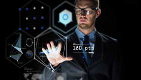 Businessman touching virtual screen projection Royalty Free Stock Image