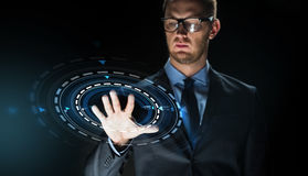 Businessman touching virtual screen projection Royalty Free Stock Images