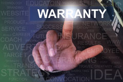 Businessman touching warranty button on virtual screen Stock Images