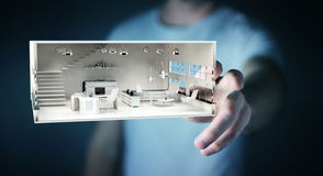 Businessman touching white 3D rendering apartment. Businessman on blurred background touching white 3D rendering apartment Stock Photos