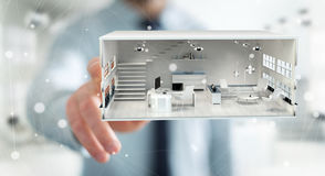 Businessman touching white 3D rendering apartment. Businessman on blurred background touching white 3D rendering apartment Royalty Free Stock Photo