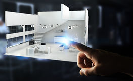 Businessman touching white 3D rendering apartment with his finge. Businessman on blurred background touching white 3D rendering apartment with his finger Royalty Free Stock Photo