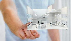 Businessman touching white 3D rendering apartment with his finge Royalty Free Stock Image