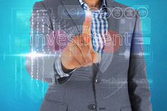 Businessman touching the word invest on interface Stock Images