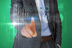 Businessman touching the word skill on interface Royalty Free Stock Image