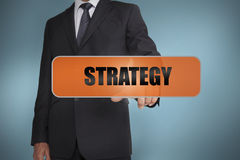 Businessman touching the word strategy Stock Photos