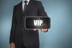 Businessman touching the word vip Royalty Free Stock Photo