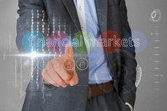 Businessman touching the words financial markets on interface Royalty Free Stock Photos