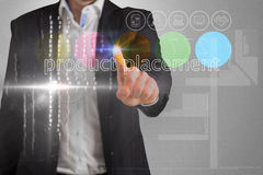Businessman touching the words product placement on interface Stock Photography