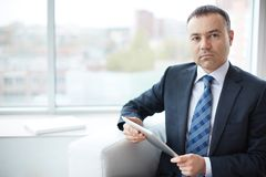 Businessman with touchpad Stock Image