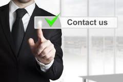 Businessman touchscreen button contact us Stock Photo