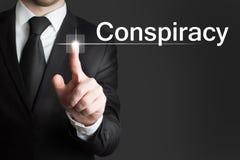 Businessman touchscreen conspiracy. Businessman pressing touchscreen button conspiracy Royalty Free Stock Photo